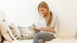 Woman  using digital tablet in home