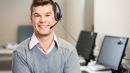 Portrait of confident male customer service representative with